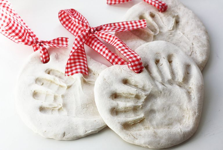 Handprint ornaments with a ribbon.