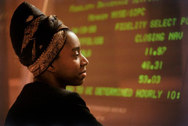 woman looking at stock prices