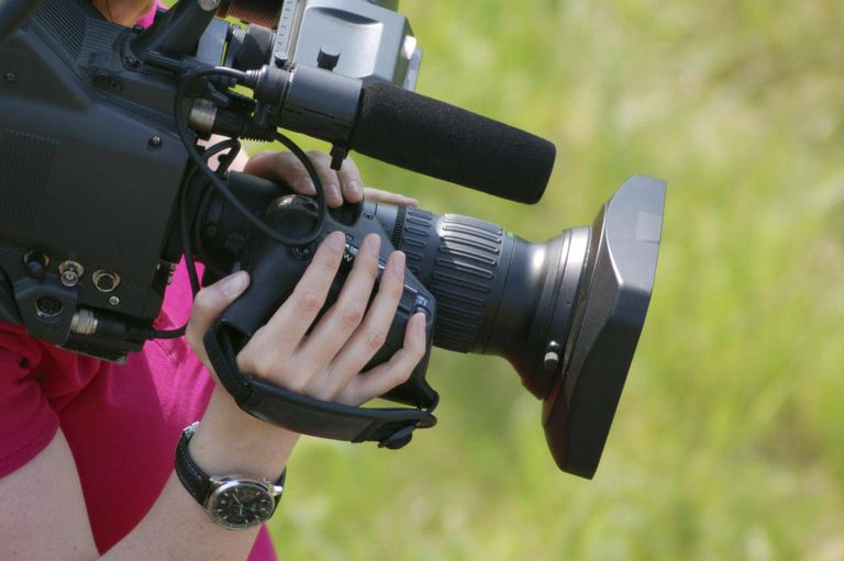 Cinematographer holding camera