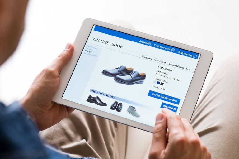 man online shopping on ipad