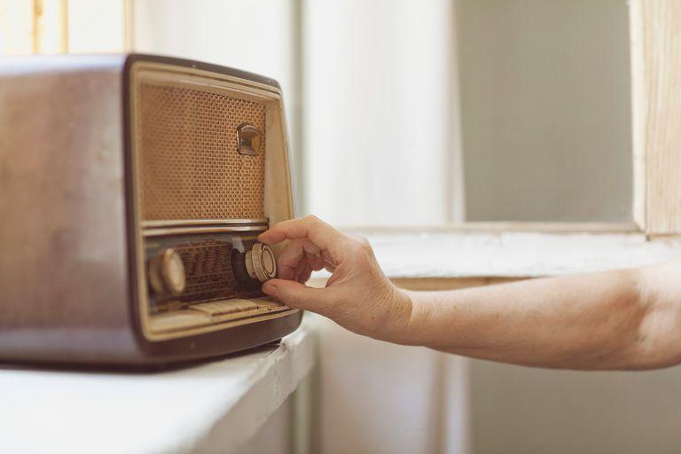 Woman use an old traditional radio
