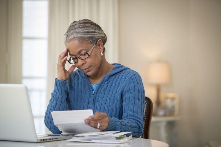 Woman preparing to do taxes.