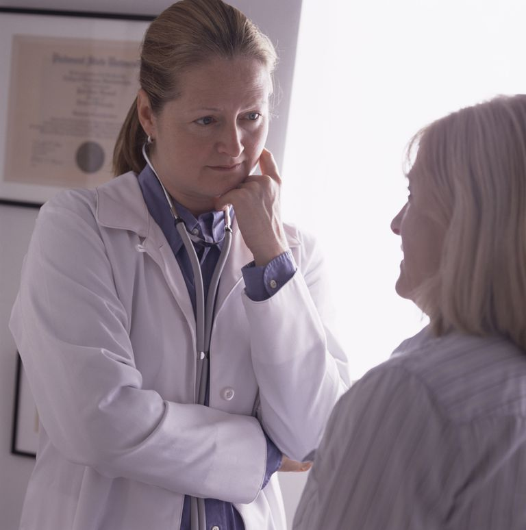 Doctor carefully listening to her patient