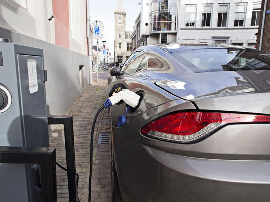 Electric car at recharging station