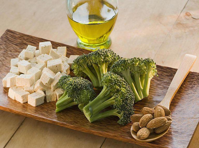 Tofu, almonds, broccoli and olive oil, still life
