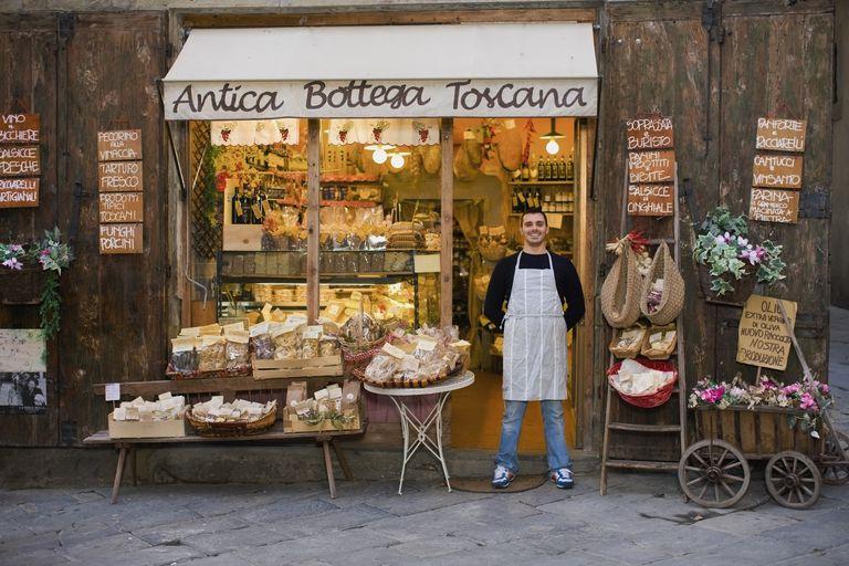 Italian owner standing in front of deli