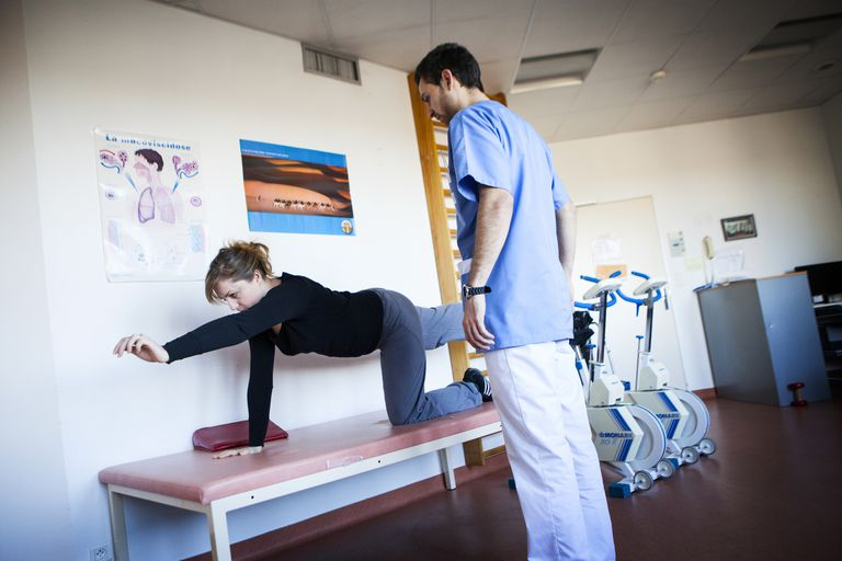 Woman completing physical therapy