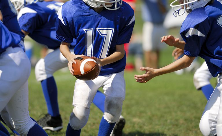 Is football safe for your kid, and is modified tackle the answer?
