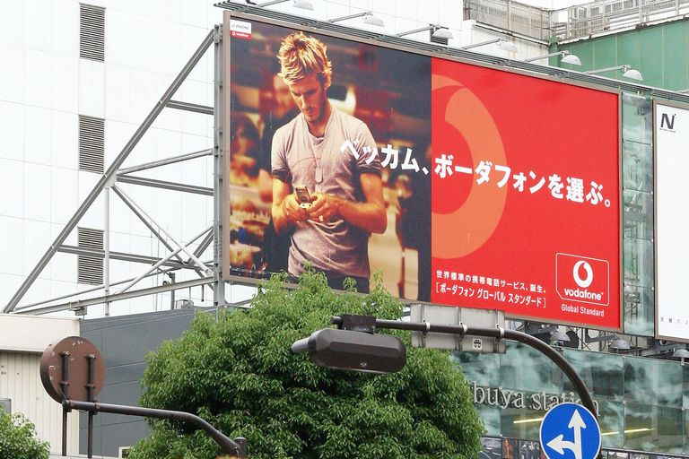 English soccer star and captain of the England Football Team David Beckham is pictured on an advertising billboard on June 19, 2003 in Tokyo, Japan.