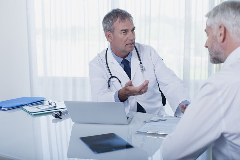 male doctor with male patient