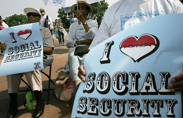 "People holding ""I love social security"" signs"
