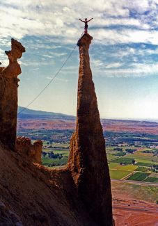 Martha Morris stands on the summit of a spire near Grand Junction, Colorado.