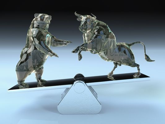 Bull and bear balancing on seesaw