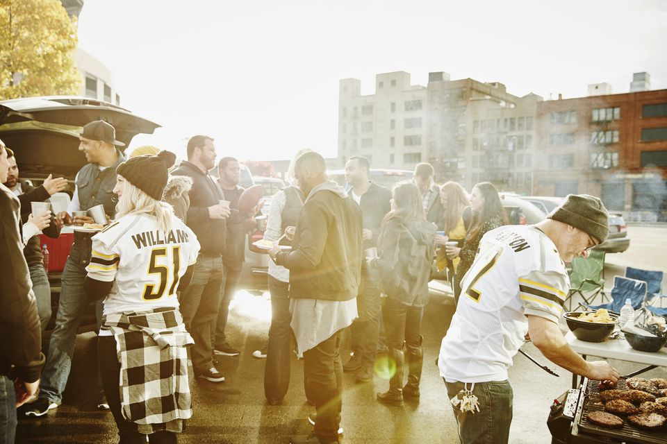 Friends tailgating in stadium parking lot