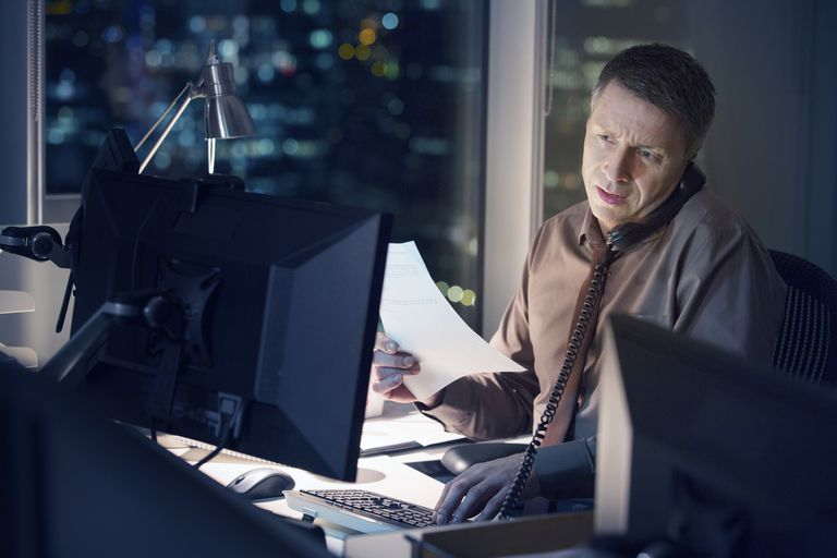 Businessman working late at computer in office