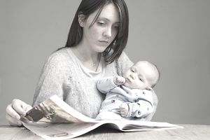 Mother reading with her baby