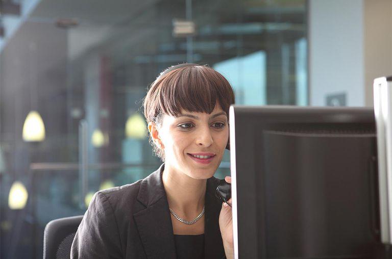 Businesswoman talking on phone at desk
