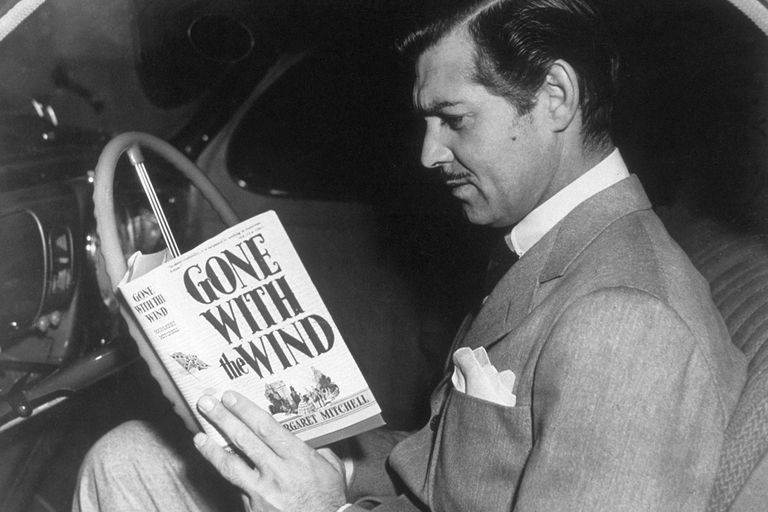 American film star Clark Gable (1901-1960) reading the novel 'Gone With the Wind' by Margaret Mitchell.