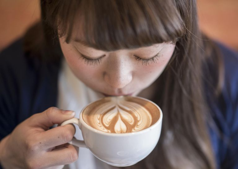 Woman drinking cafe latte.