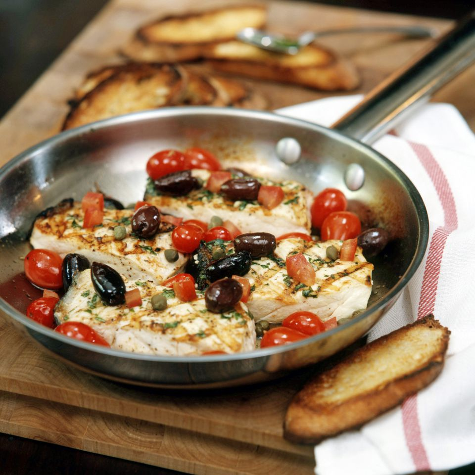 Grilled Halibut in Skillet with Olives, Capers and Tomatoes
