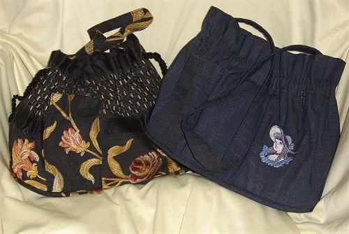 A photo of two everyday style pcoketbooks made with the free pattern.