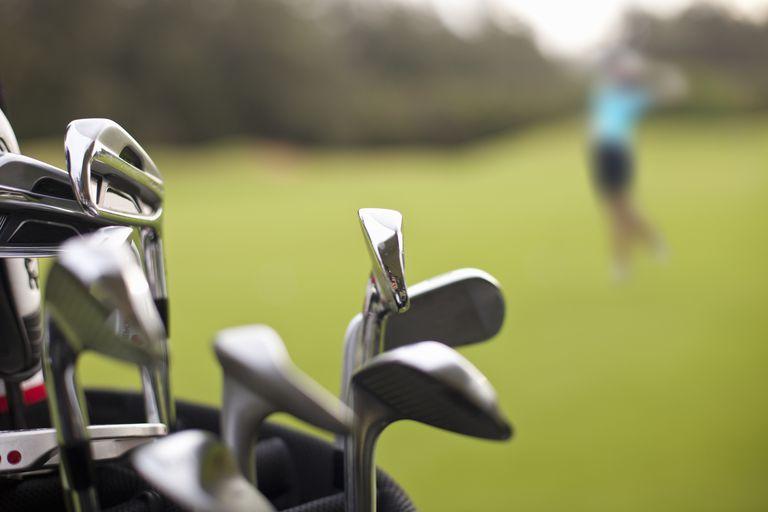 Golf clubs in a golfer's bag