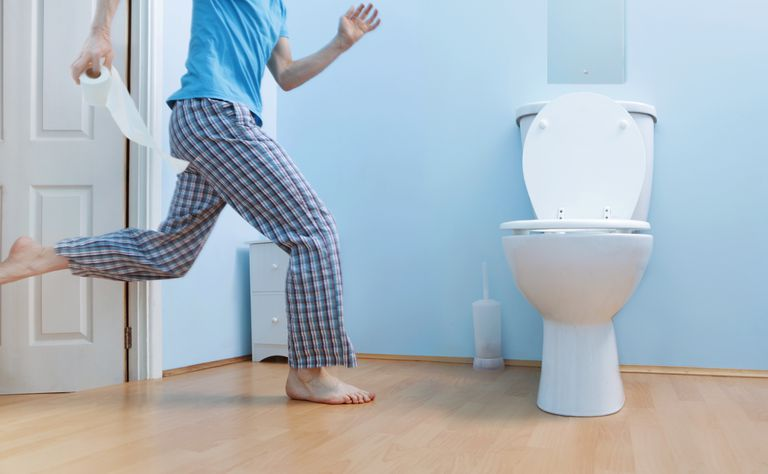 Man running to toilet