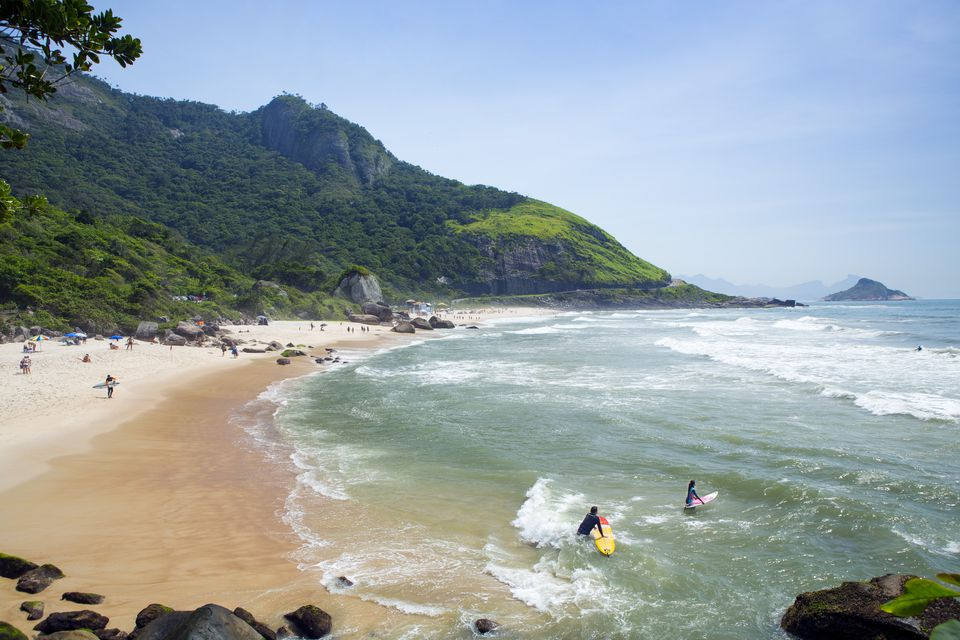 Surfers on Prainha beach, Barra da Tijuca, Rio de Janeiro, Brazil, South America