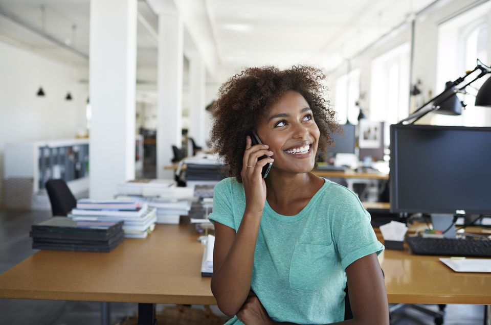 businesswoman smiling on phone