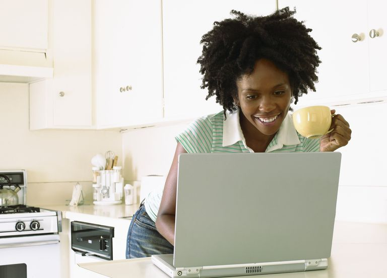 Woman blogging in kitchen