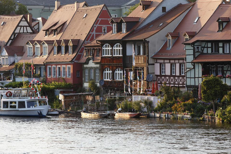 Germany, Bavaria, Bamberg, View of historic district against regnitz river