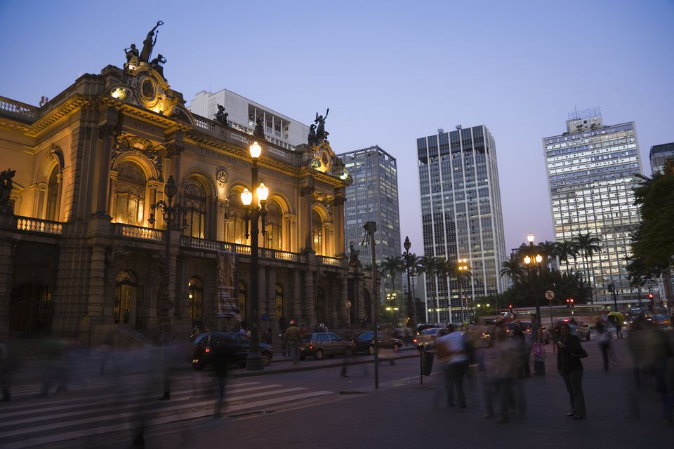 Teatro Municipal and office buildings at dusk