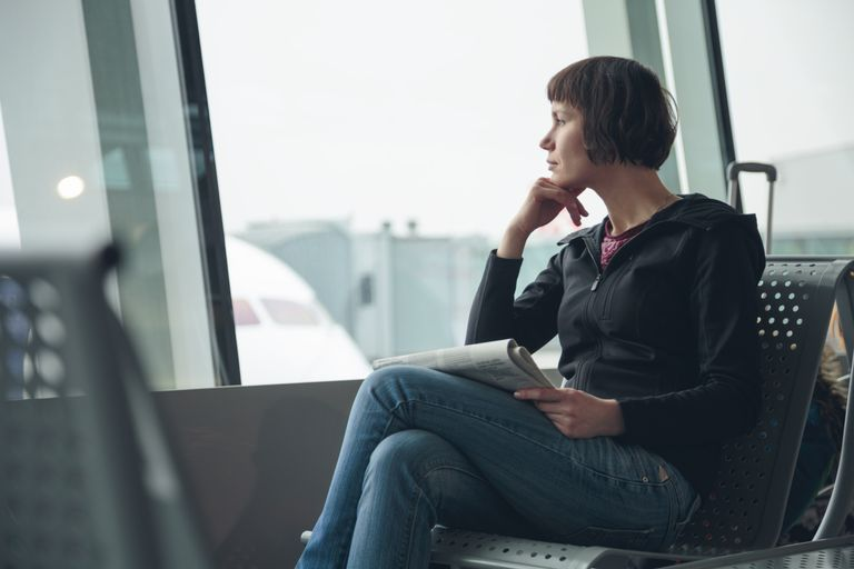 Woman waiting in airport departure hall