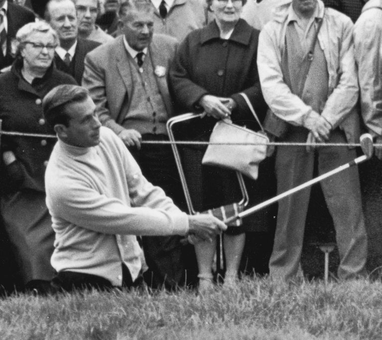 Dave Marr plays out of a bunker on the fourth, during a Ryder Cup match at Royal Birkdale, 9th October 1965