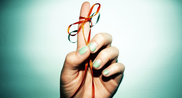 Reminder Ribbon Tied to Finger
