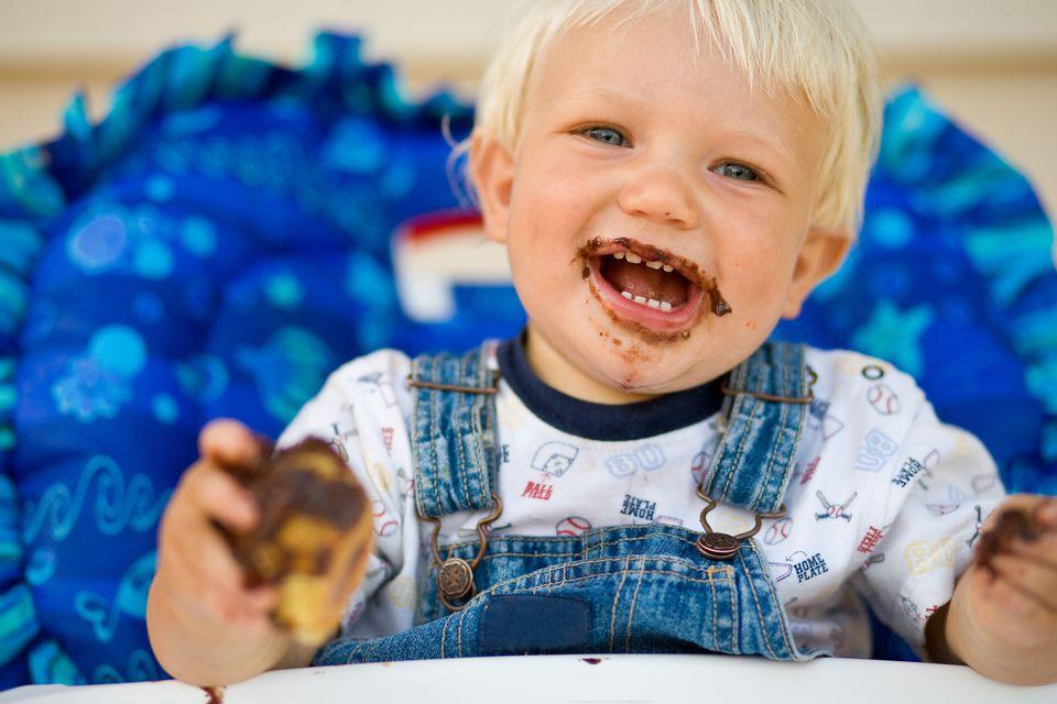 Boy eating chocolate cupcake