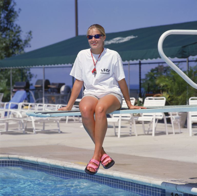 lifeguard sitting on diving board