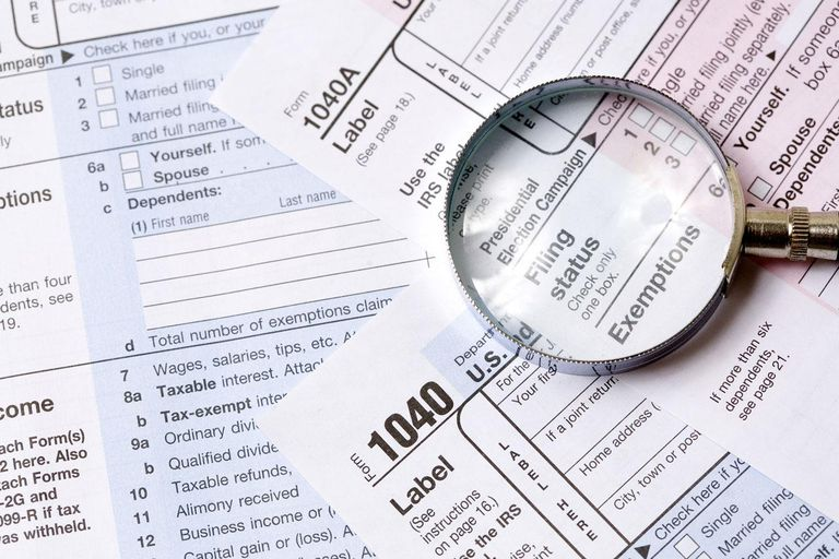Tax form and magnifying glass