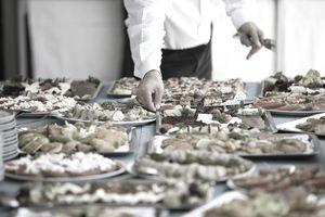 Man serving buffet plates