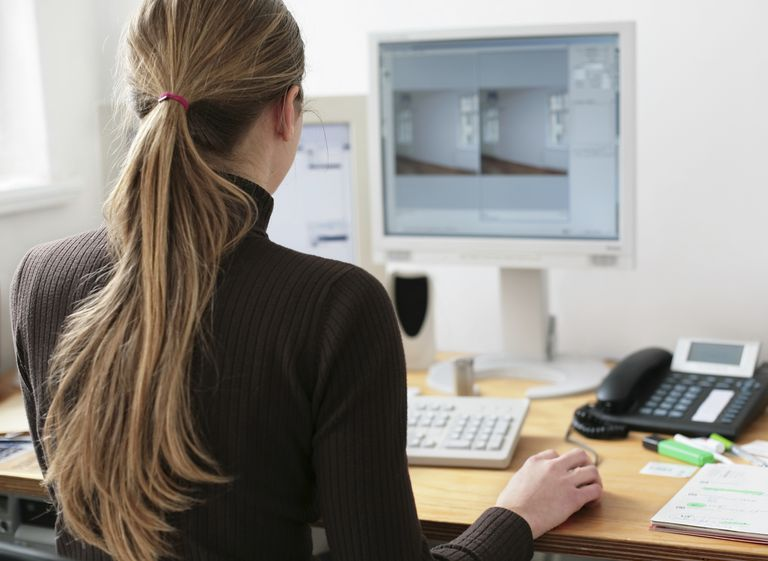 Young female architect in front of a computer screen