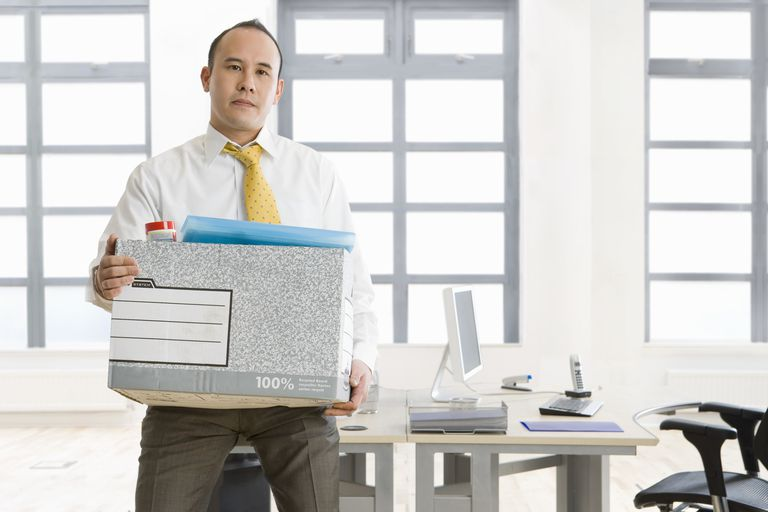 Man with packed box ready to leave office