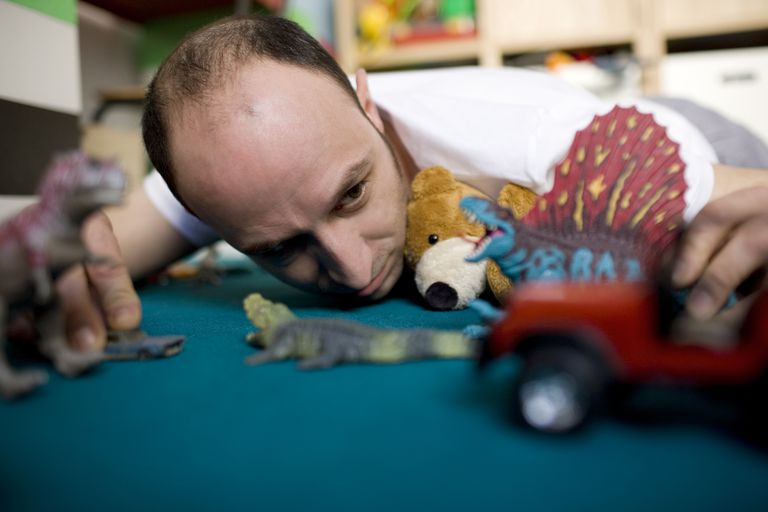 man plays with toys