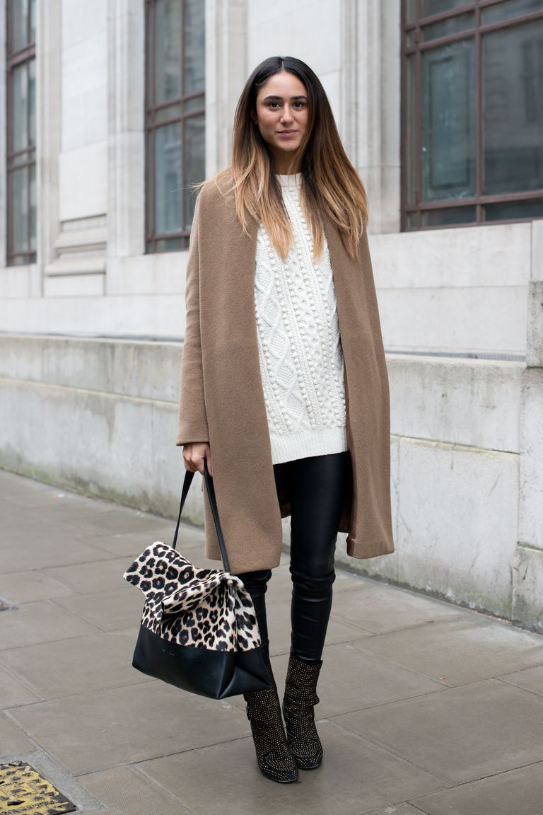 Woman in leather leggings and sweater and coat