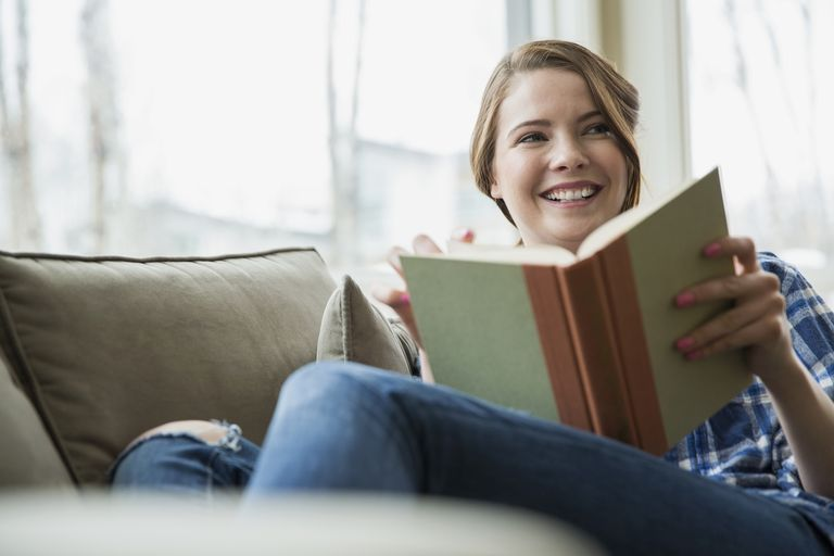 Woman reading a book aloud
