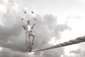 Man on a tightrope juggling