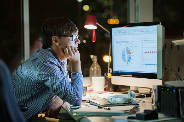 Man looking at graphs