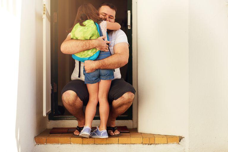 Girl hugging father