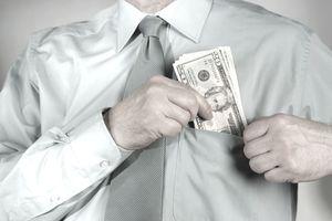 a man sticking money in his pocket