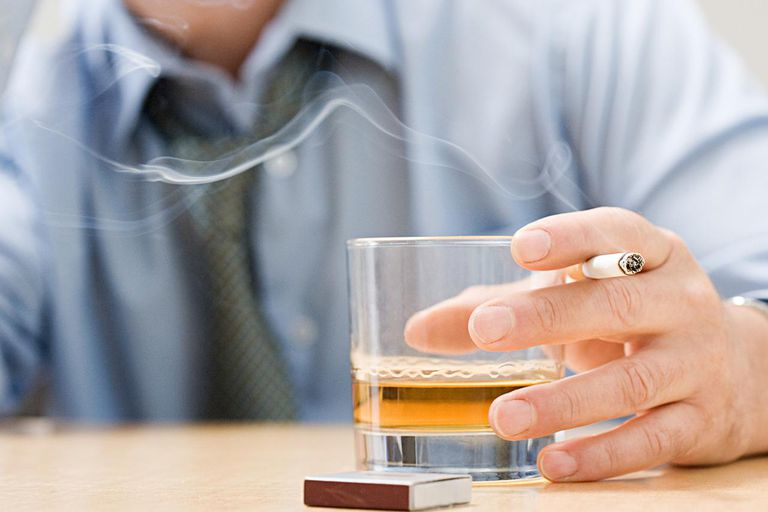 Man drinking whisky and smoking