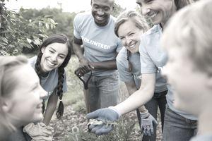 Volunteers talking in a community garden.